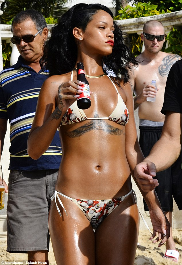 Me and my Bud: Rihanna cooled down with an ice cold bottle of beer