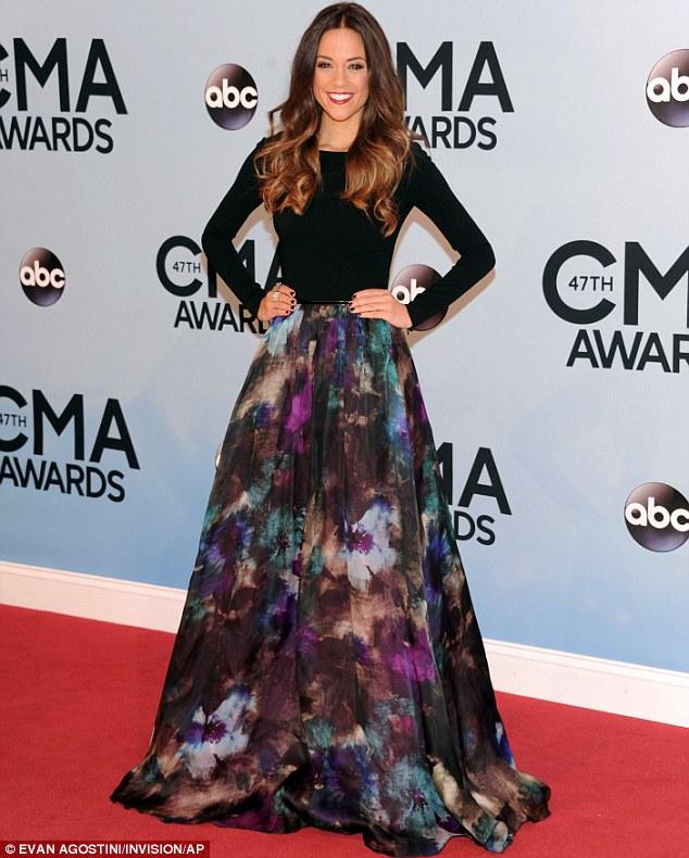 Flower girl: Jana Kramer arrives in style at the 47th annual CMA Awards
