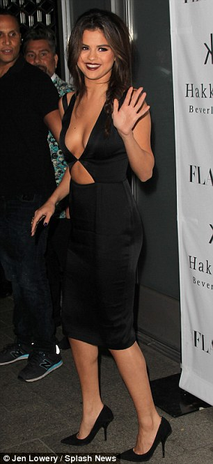 No jewelry needed: The 21-year-old starlet amped up her cleavage in a revealing cut-out black dress and pumps