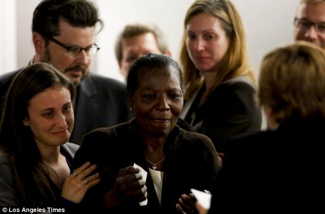 Overcome: Register's mother, Wilma Register, pictured centre, wept uncontrollably as her son was released