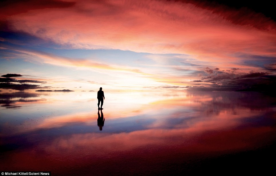 Walking to heaven: This tranquil images captures reflections of the beautiful red Bolivian sky in an area of the country which is off the beaten track