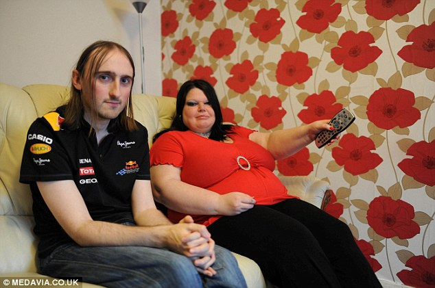 Controlling: Debbi Wood, 42, of Leicester, is so paranoid that her partner Steve Wood, 30, will stray that she also checks his phone, email accounts and bank statements several times a day for evidence of infidelity