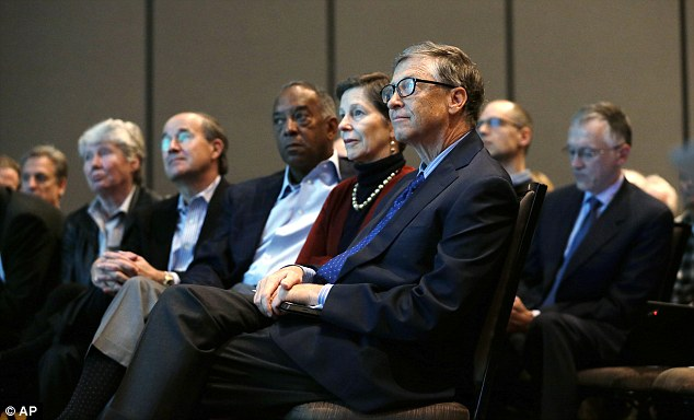 Microsoft chairman Bill Gates, front right, sits with other company officers at today's annual shareholders meeting in Bellevue, Washington