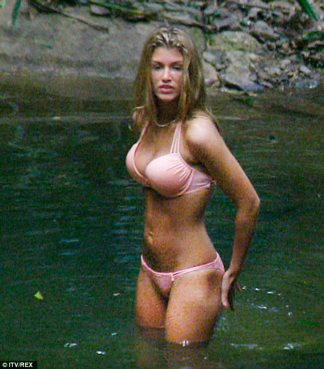 Suits you: Amy took a tentative step into the water where she showed off her enviable figure