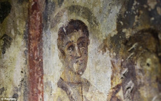 A fresco is pictured inside the catacomb of Priscilla in Rome