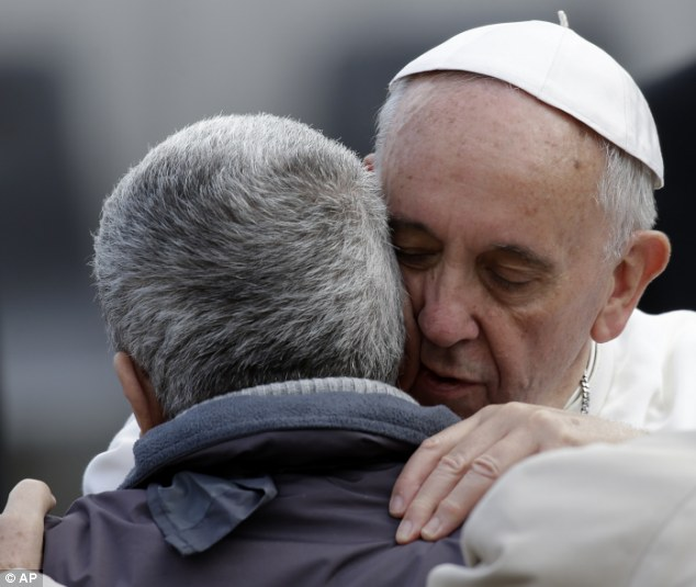Personal connection: Pope Francis leant in to hug and kiss the man and give him his blessing at the end of his audience in the Vatican today