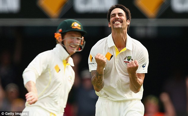 Smiles better: A beaming Johnson can't hide his delight after dismissing Graeme Swann