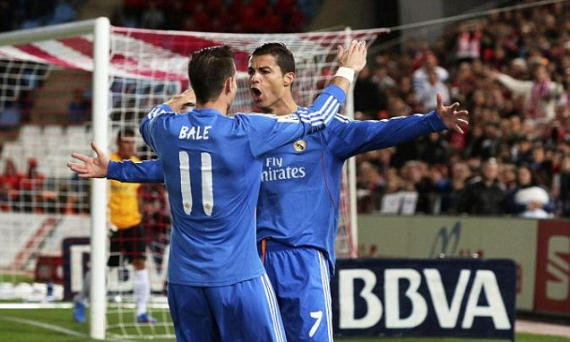 Kings of Spain: Cristiano Ronaldo and Gareth Bale celebrate after Real Madrid score their first