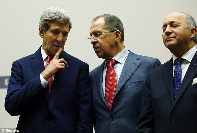 History has been made: U.S. Secretary of State John Kerry talks with Russia's Foreign Minister Sergei Lavrov next to French Foreign Minister Laurent Fabius (L-R)