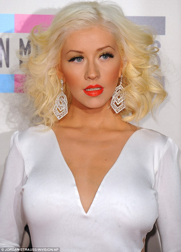 Glamour puss: The 32-year-old singer dropped jaws in the sexy white gown