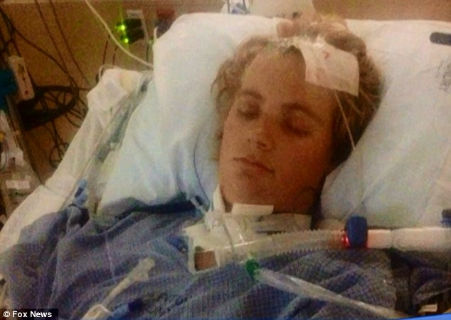 Coma: Chandler Webb, 19, lies in his hospital bed in Intermountain Medical Center in Murray, Utah - from which he never awoke and passed away on Tuesday - just five weeks after he was given a flu-shot