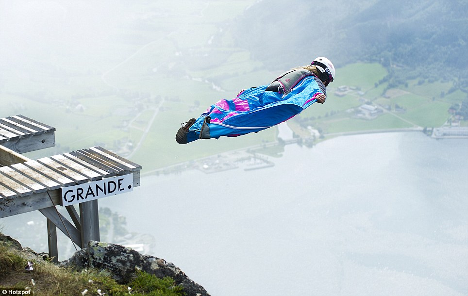 Lift off: Miss Brennan launches herself into another epic wingsuit jump in Norway