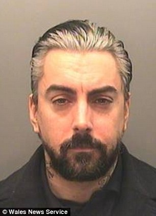 Mug shot: Lostprophets singer Ian Watkins faces jail today after he admitted a series of sexual offences against babies