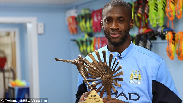 Chosen one: Yaya Toure holds his African Footballer of the Year award