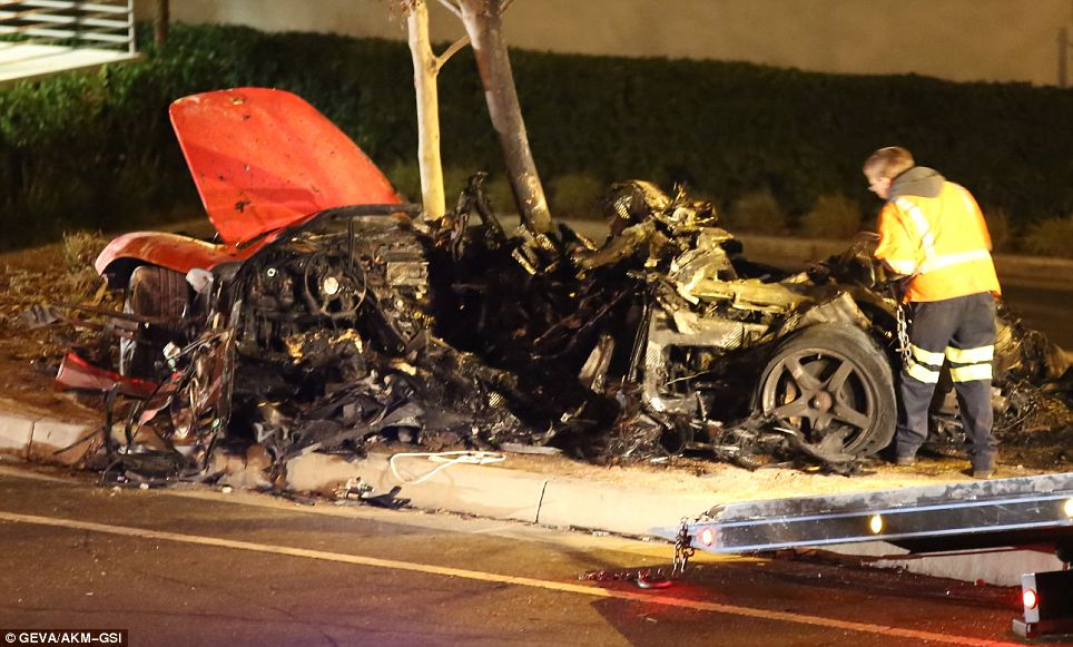 No survivors: The remains of the Porsche Carrera GT lie where the vehicle came to rest. The steering wheel shows the driver's position, meaning that Walker would have been sitting at the point where the vehicle struck the trees