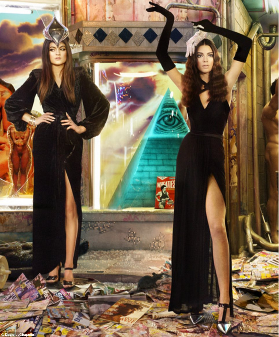 Sister act: Kendall (R) and Kylie Jenner wore similar black dresses while stood amongst various tabloid magazines with members of the famous family on the cover