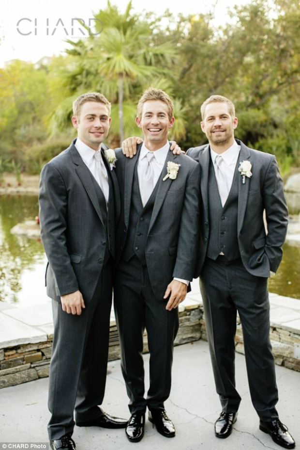 Smiles: Beaming, the Walker brothers, from left, Cody, Caleb and Paul, pose in the fall sunshine at Caleb's October wedding