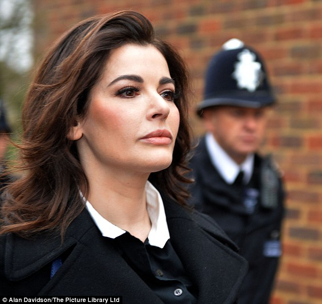 Determined: Nigella Lawson, seen arriving at court this morning, cut a severe figure as she arrived at court this morning