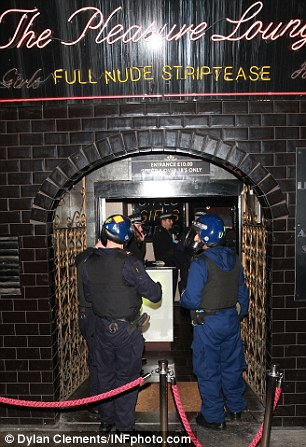 Police officers at a premises