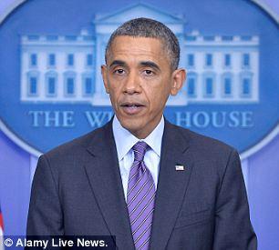 Alamy Live News. DKGHWX Washington, Washington DC. 5th Dec, 2013. U.S. President Barack Obama de
