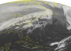 Storm: This NOAA satellite image taken early Friday shows clouds streaming from the Mississippi and Ohio Valleys into the Mid-Atlantic and Northeast, associated with a strong Arctic front