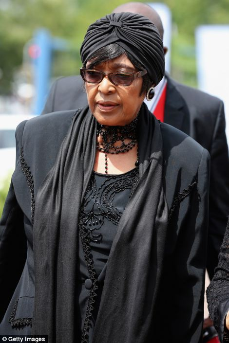 Shrouded in black, Winnie Madikizela-Mandela arrives for the service at Bryanston Methodist Church