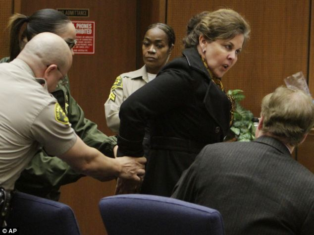 Former Assistant City Manager Angela Spaccia is led away in handcuffs after being found guilty of a string of corruption charges