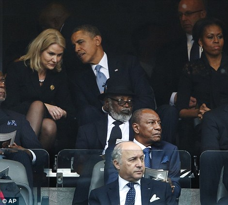 First Lady Michelle Obama did not look too pleased as her husband laughed and joked with the Danish PM Helle Thorning-Schmidt at the memorial service