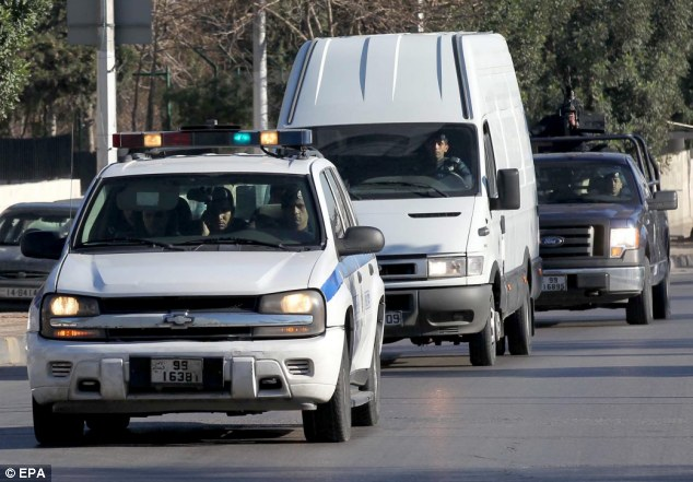 Arriving: A special police force convoy carrying Abu Qatada arrives at the State Security Court where he later refused to recognise the tribunal