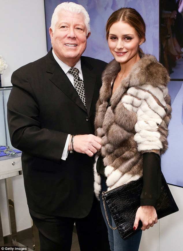 Designer darling: The fashion blogger posed with designer Dennis Basso who, besides being the go-to man for furs, also sells custom gowns and jewelry