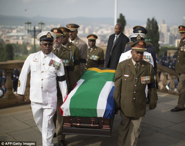 Tribute: Military officers carry the coffin of former president Nelson Mandela into the Union Buildings in the South African capital Pretoria, the seat of government where he will lie in state for three days
