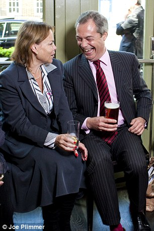 Joke: UKIP leader Nigel Farage chuckles at a meeting with under-fire 'rising star' Victoria Ayling