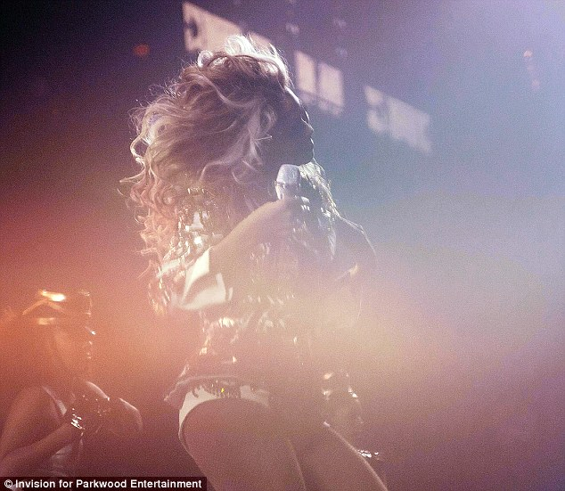 Shake it: Beyonce tossed that blonde and honey-streaked mane as she sang one of her hits