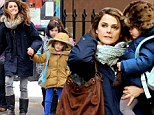 To be a kid again! Keri Russell fits in some festive fun with her children on school pick up in snowy New York