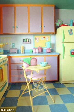 Colorful: In the blue and yellow tiled kitchen, pots and pans in primary colors line the blue counter, and baby Maggie's high chair sits in a corner