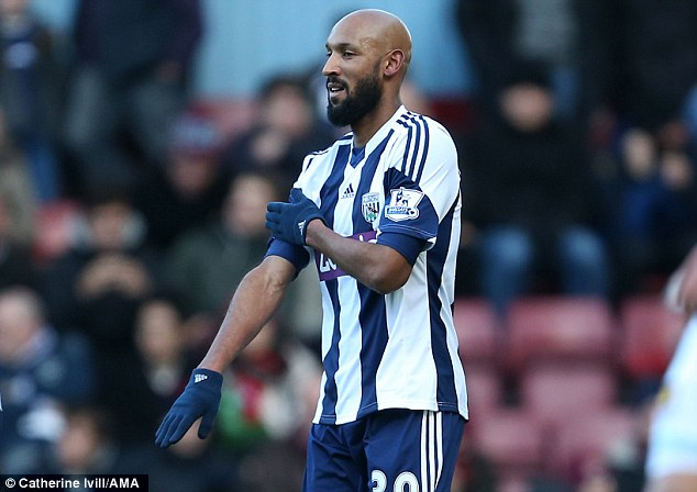 Gesture: Nicolas Anelka celebrates the first of his two goals against West Ham in the 3-3 draw