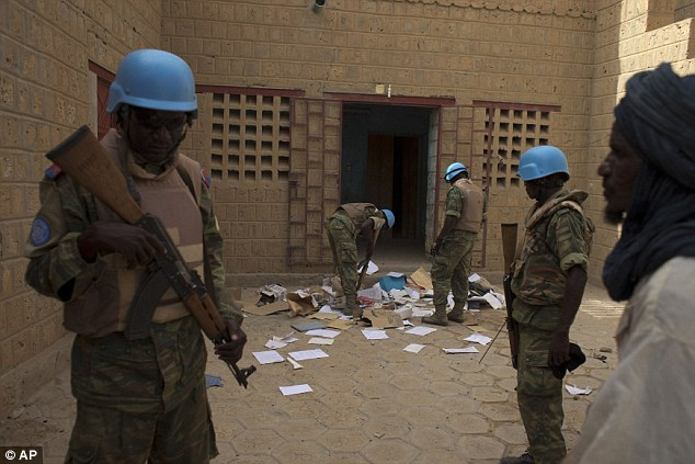 Raid: In this July 23, 2013 file photo, United Nations peacekeepers search a house suspected to have been used by members of al-QaidaÃ's North African branch in Timbuktu, Mali