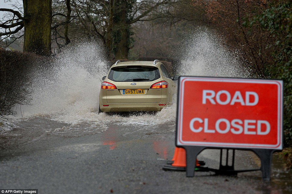 More disruption: After a nightmare Christmas week roads all over the UK have been blocked by floods and landslides caused by heavy rain, still making the Monday commute completely miserable for many