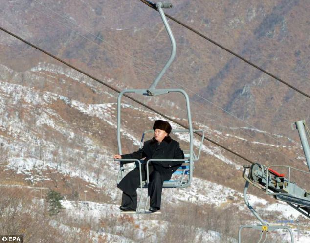 North Korean leader Kim Jong-Un surveys the country's first ski resort Masik Pass, from a chair lift. But the Switzerland-educated leader appears to have left his skis behind