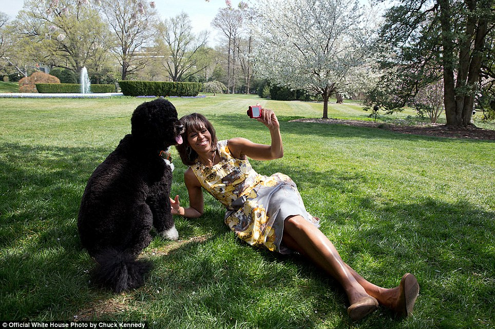 Chuck Kennedy photographed the First Lady as she takes a selfie with Bo, the Obama family dog, for National Geographic
