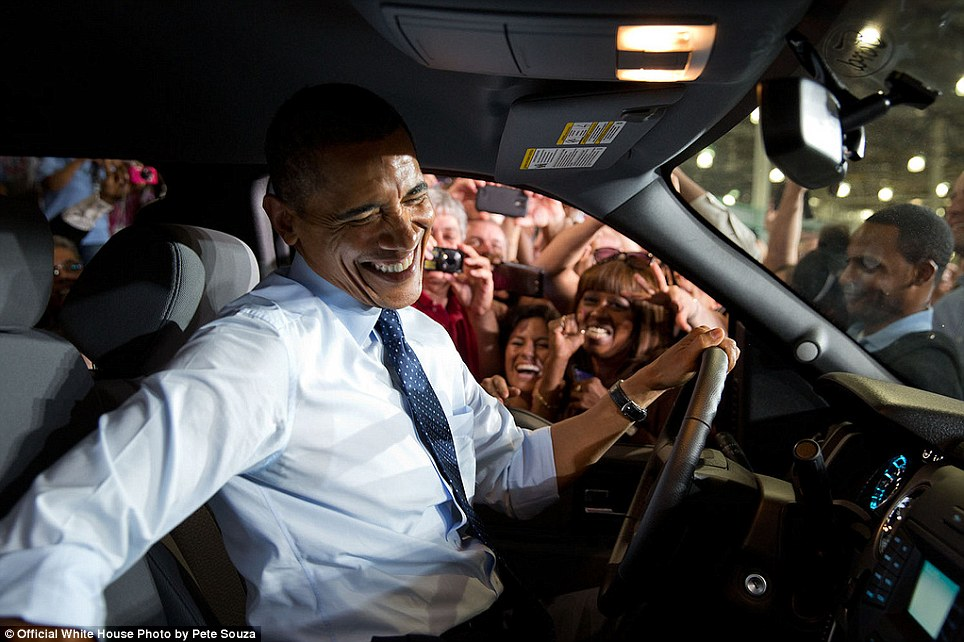 September 20, 2013. 'A Ford truck was stationed nearby the podium while the President delivered remarks on the economy at the Ford Kansas City Stamping Plant in Liberty, Missouri. After the speech, I positioned myself near the truck guessing that the President might lean over the hood of the truck to shake hands with Ford employees. Instead he opened the passenger door and slid over to the driver's seat so he could get even closer to the employees,' Souza said