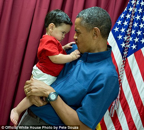 'When little kids are around, you never know what will happen. On Christmas Day, the President and First Lady were greeting almost 600 active duty troops and their families at Marine Corps Base Hawaii Kaneohe (known locally as K-Bay). This youngster gave the President a look, which he returned'