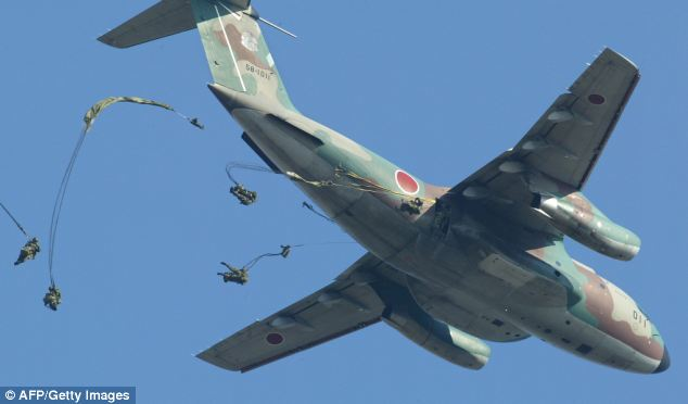 Paratroopers from Japanese Ground Self-Defense Force (JGSDF) Narashino 1st Airborne Brigade jump out from a military plane