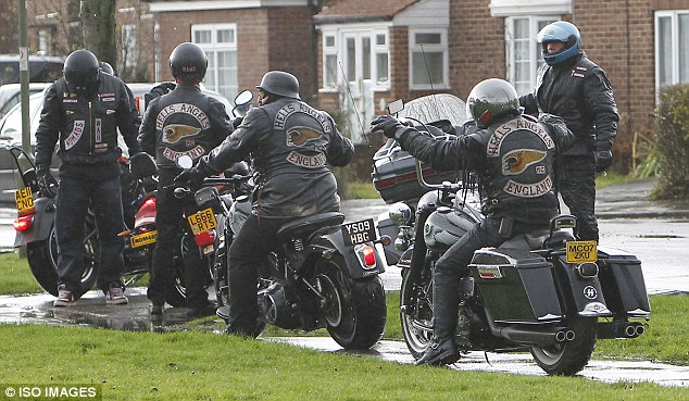 Tribute act: The bikers arrive at Ronnie Biggs' family's home in Barnet, north London, to make the journey to the crematorium
