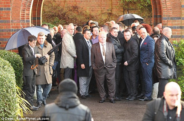 Crowd: Old criminals, family and friends of Ronnie Biggs attend the funeral of the convicted thief who spent 36 years on the run