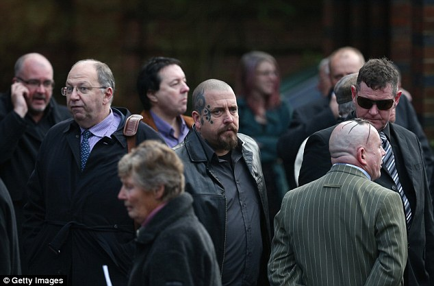 Grief: Guests arrive at Ronnie Biggs' funeral in north London today after he died last month following a long illness