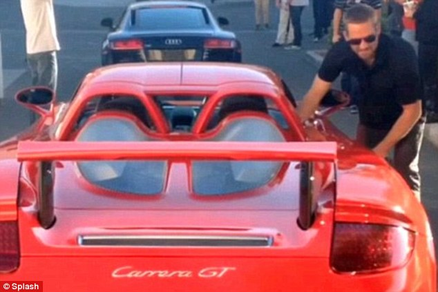 Just before the crash: The last image of the actor as he got into the red Porsche Carrera GT that killed him