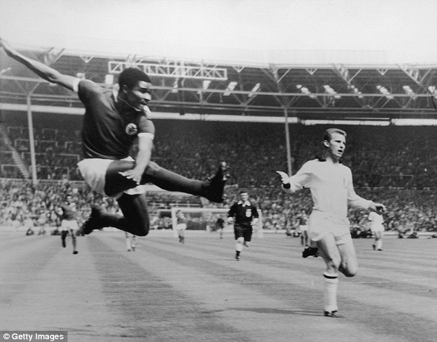 Superb technique: Eusebio scores with a flying kick in the 1963 European Cup final with AC Milan at Wembley