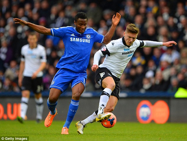 Close quarters: Derby's John Hendrick (right) shields the ball from Chelsea's Mikel