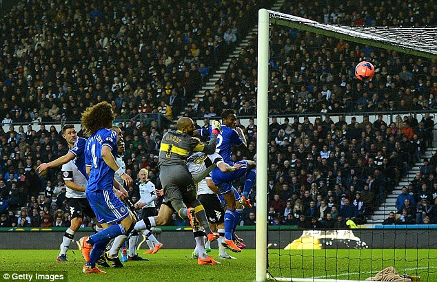 Opener: Mikel heads the ball into the net to break the deadlock for Chelsea in the 66th minute